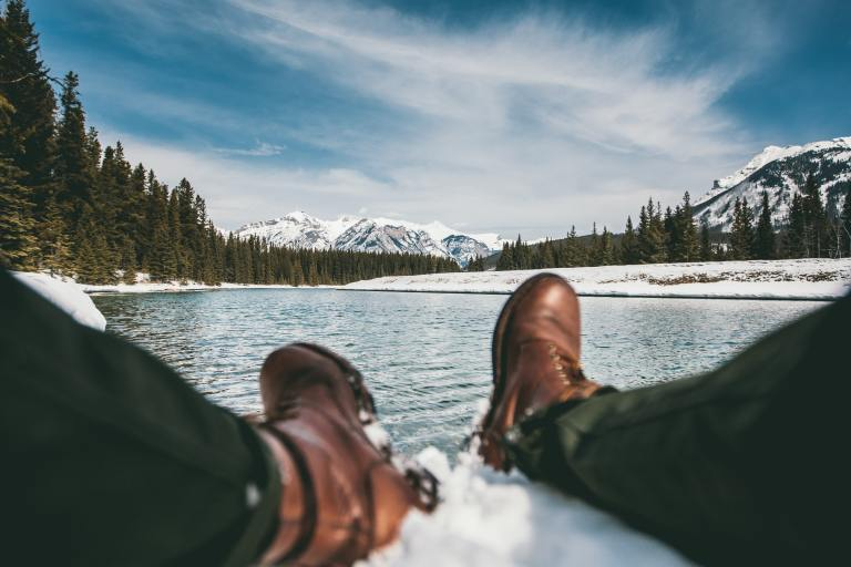 Person wearing winter hiking boots in Canadian mountains.