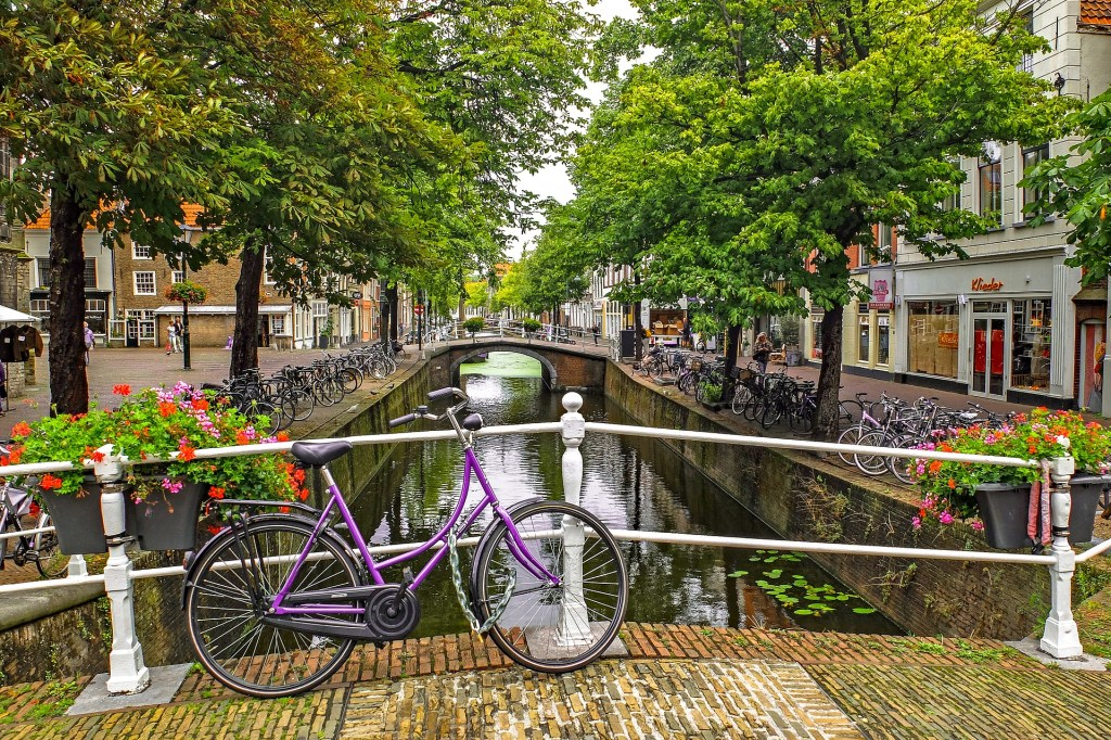 A purple bike chained to a bridge in Delft, Netherlands