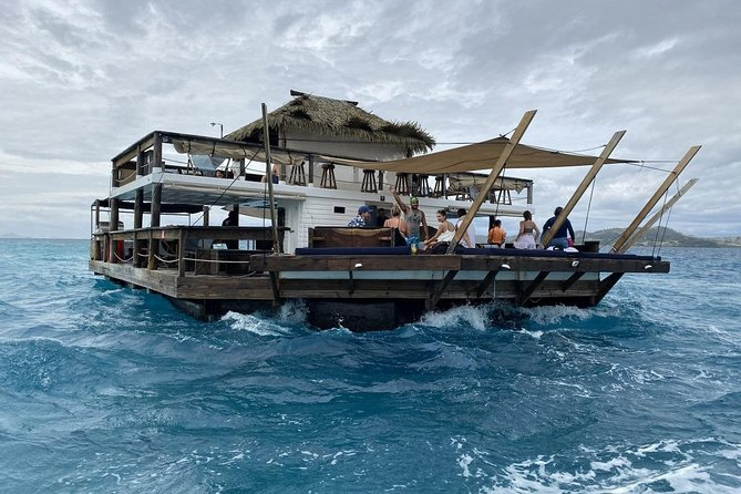 Tourists on a floating bar.