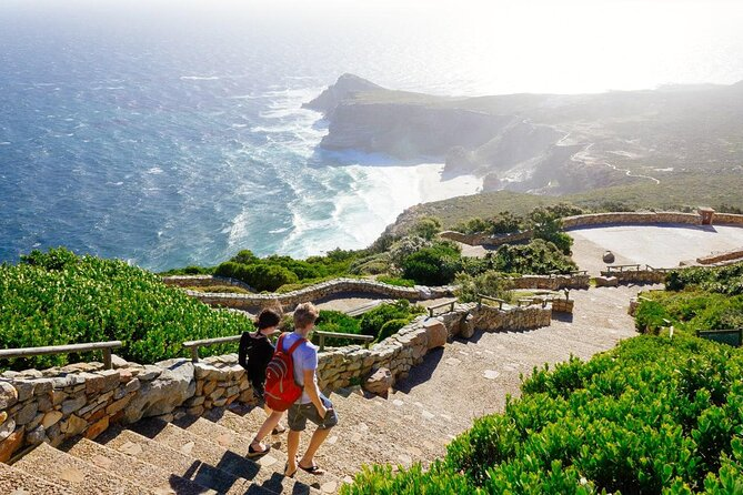 Two people walking down the stairs at Cape Point near Cape Town.