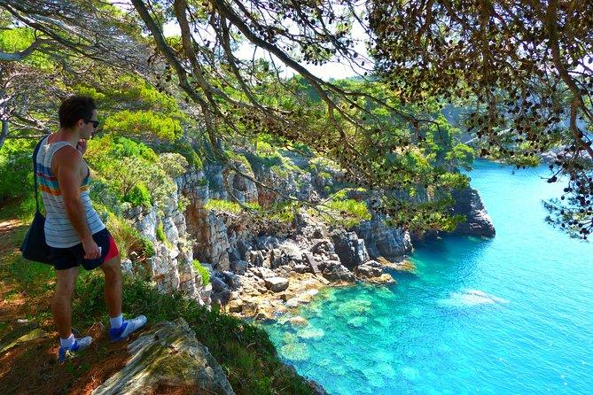 Man hiking on an Island coast in Croatia.