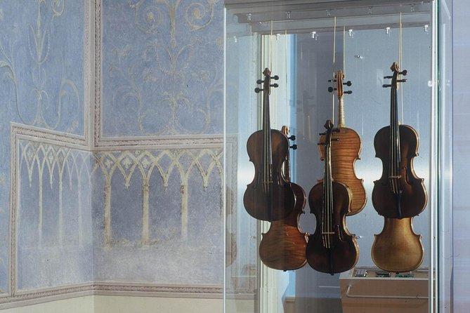 6 violins in a glass display case in Prague.