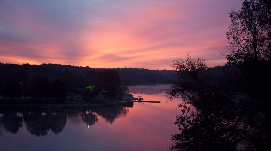 The sun rises over Miami Whitewater Forest Lake.