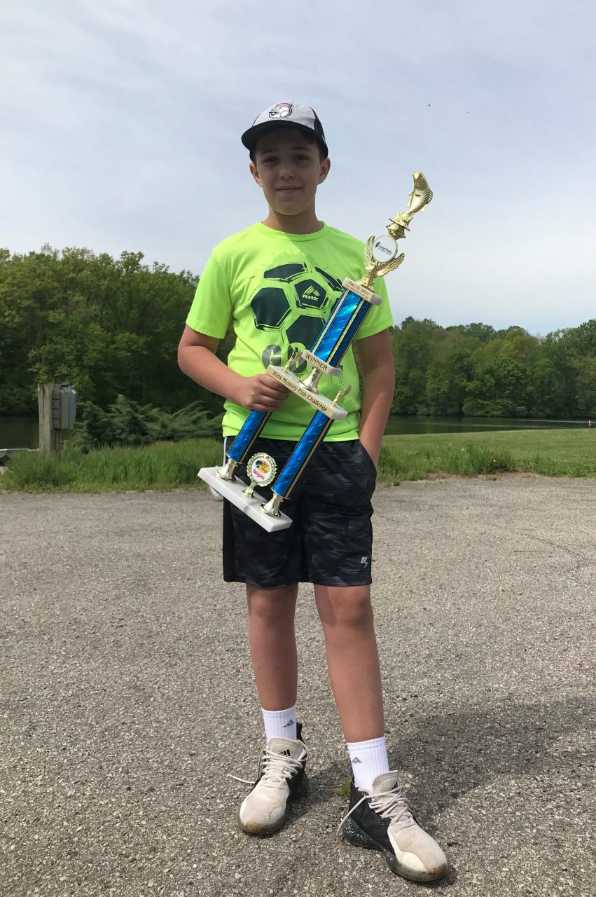 Hayden with his winning trophy at the Kids' Mystery Fish Challenge on May 15, 2021.