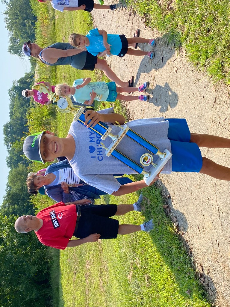 Brandon with his winning trophy at the Kids' Mystery Fish Challenge on July 24, 2021.