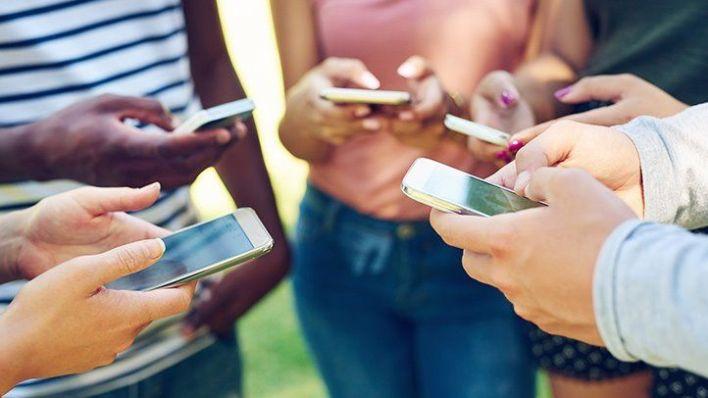 Teenagers with smartphones
