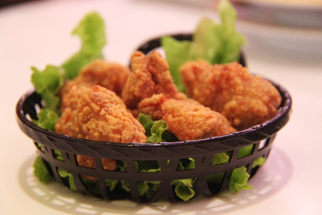 Chicken strips and lettuce in a basket at a Chick Fil A fundraiser