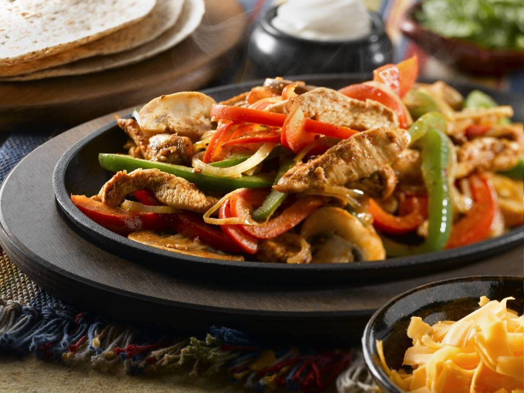 Try the fajitas at Tequila Grande, they're delicious.