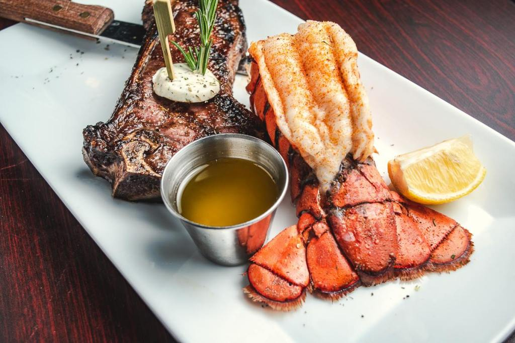 Steak and lobster tail on a plate at The Horseshoe Grill