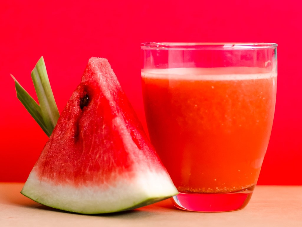 Slice of watermelon and glass of juice at a Juice It Up fundraising event