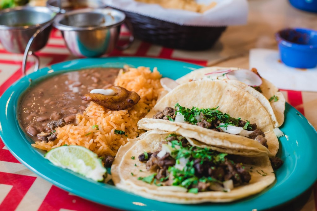 Plate with tacos, Spanish rice, and beans at an On the Border fundraising event