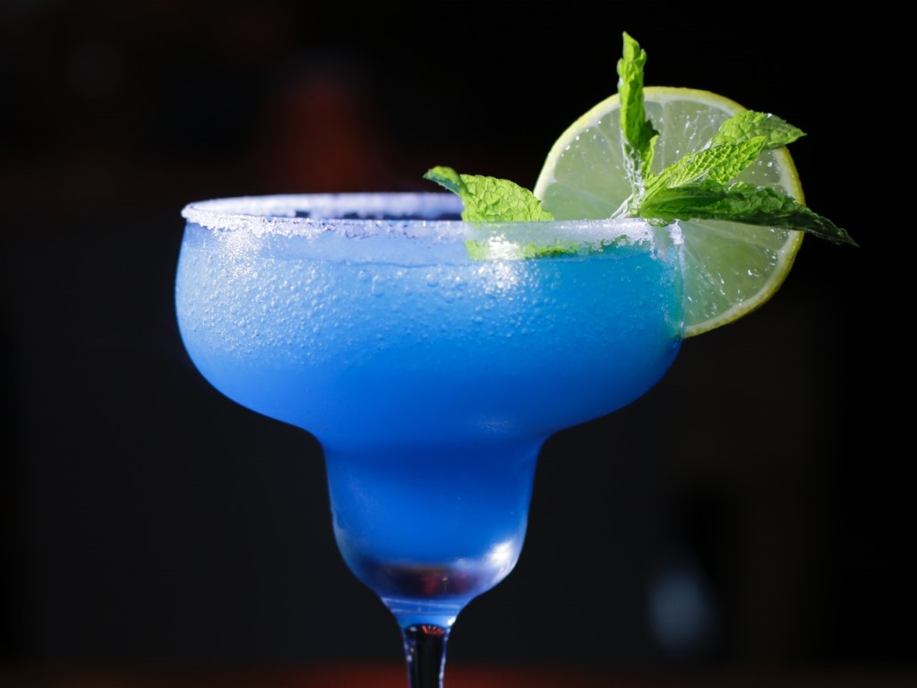 Blue margarita with lime slice at a 3 Margaritas fundraiser