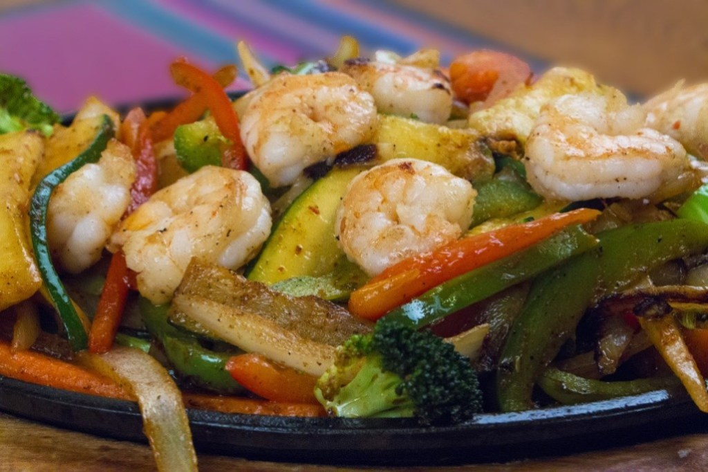 Close-up of delicious shrimp fajitas at a 3 Margaritas fundraiser