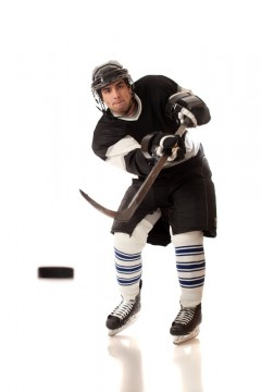 Hockey player hitting a puck