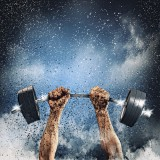 Barbell with weights lifted into the air