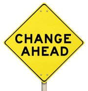 "A yellow diamond-shaped road sign cautions with ""Change Ahead."""