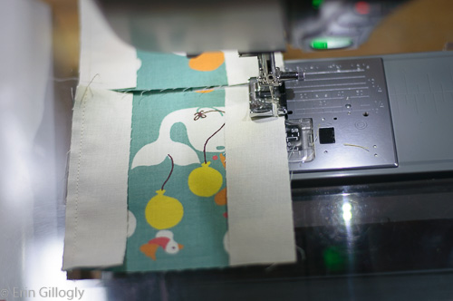 photo of a sewing machine and fabric being sewn together