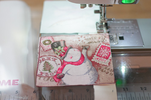 photo of a sewing machine with piecing on it.