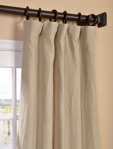 Understated drapes may be just what you need to soften a loft