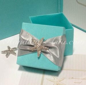 Handmade tiffany blue silk favor box with starfish brooch