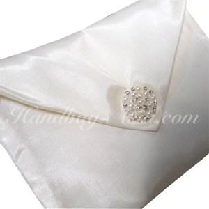 Ivory silk wedding envelope with pearl brooch