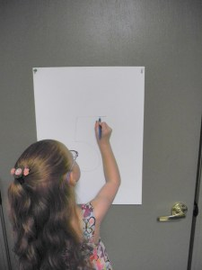 Tape paper to the wall or on the door to give children a place to write their daily schedules or jot you a note!