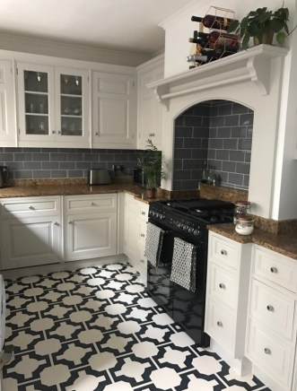 Chloe's kitchen in Parquet Charcoal by Neisha CroslandCredit: @houseinthemiddle