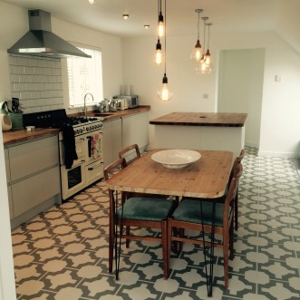 Kate's kitchen in Parquet Stone by Neisha Crosland