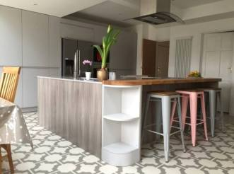 Parquet Stone by Neisha Crosland is complemented by mid-toned wood features & a pastel pop in this contemporary kitchen