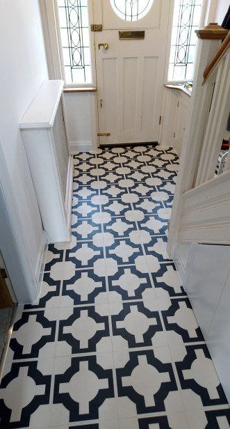 Rhys's hallway in Parquet Charcoal by Neisha Crosland