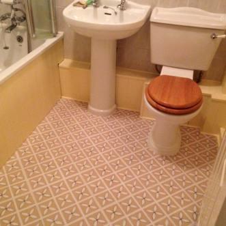 Cream floral tiles in a bathoom