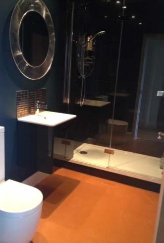 Bathroom with orange vinyl floor