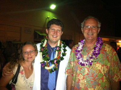 Charlie beams at his white coat ceremony along with wife, Melina Peebles and father, Larry Peebles.