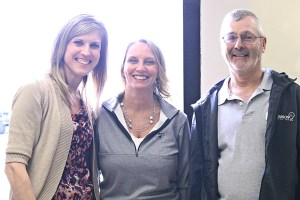 From left to right: Heartland Communications Manager Ann Hyland and Lake Area Improvement Corporation Executive Director Julie Gross celebrate with Dennis Poppen at his retirement open house.