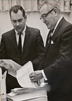 Walter Canney, left, and Virgil Hanlon review signed petitions in support of the formation of Heartland in 1968.
