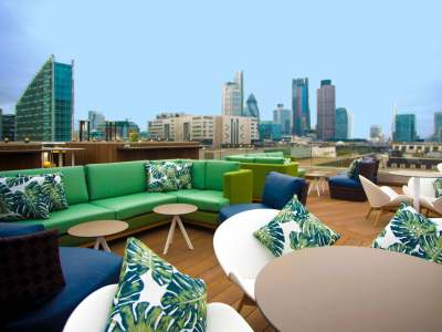 rooftop terrace with plush seating, tables and chairs