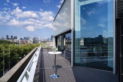 An outdoor terrace with views overlooking the city