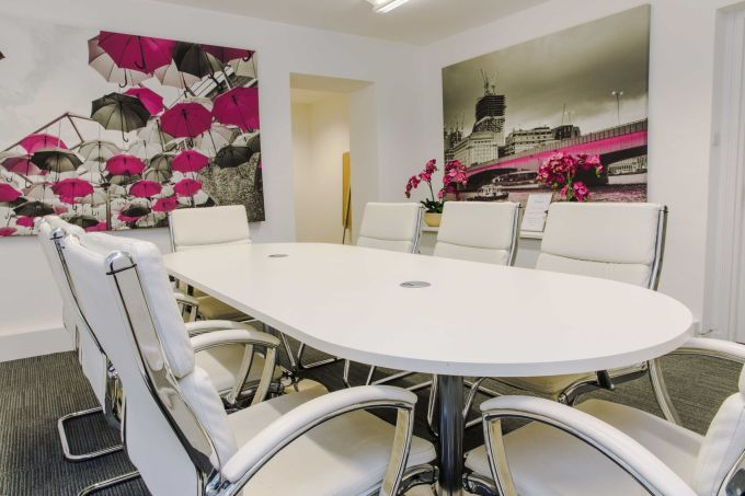 meeting room with pink umbrella painting