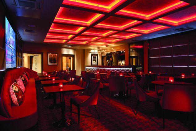 dim red lit party venue