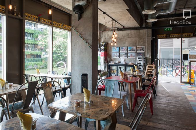 Arepa and co, private dining north london shows a warehouse looking space that's been transformed into a quirky cafe style restaurant.