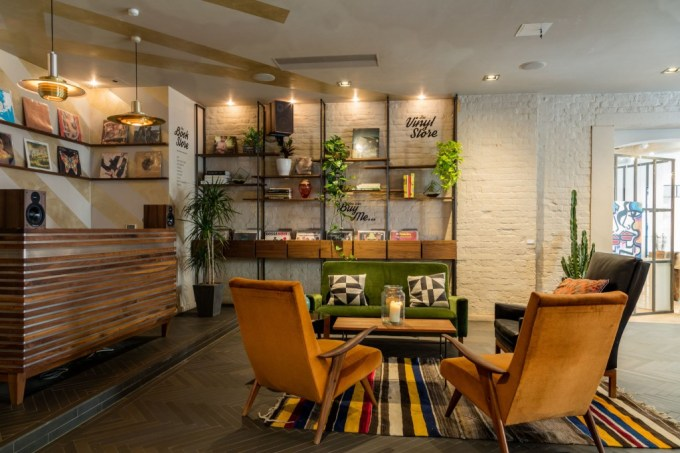 brick walled venue with bookshelves