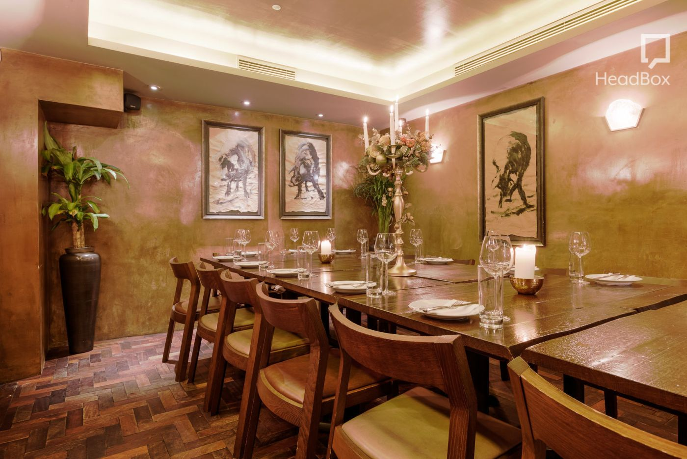A private dining room in Soho with a dark wooden table and simple design