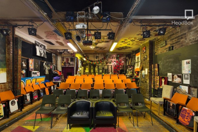 space with black and orange chairs