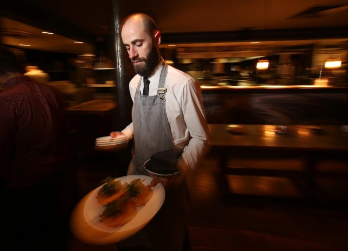 Blurred photo of waiter carrying plates
