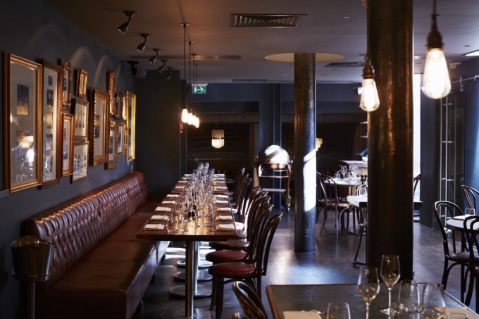 Stylish restaurant space with framed pictures