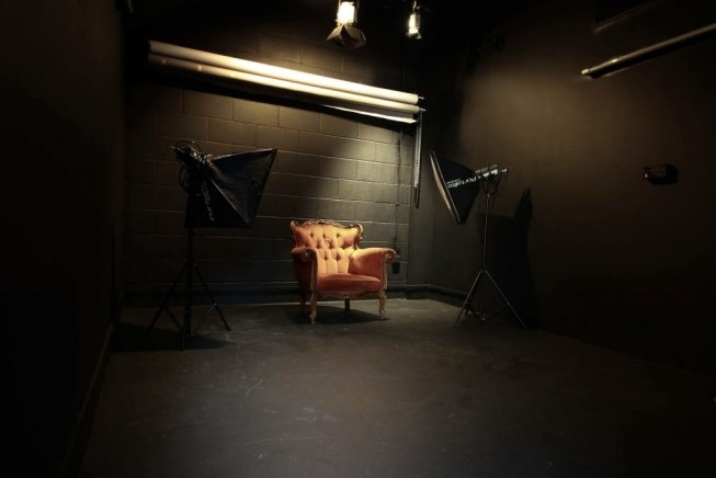 black room with two camera lights