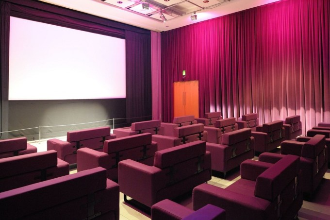 luxury cinema room with red curtains