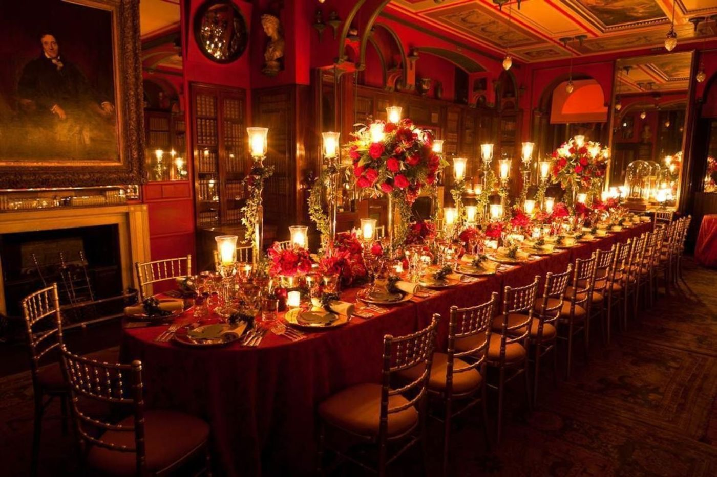 A long private dining table with red lights and large candles. One of the best unique private dining rooms london