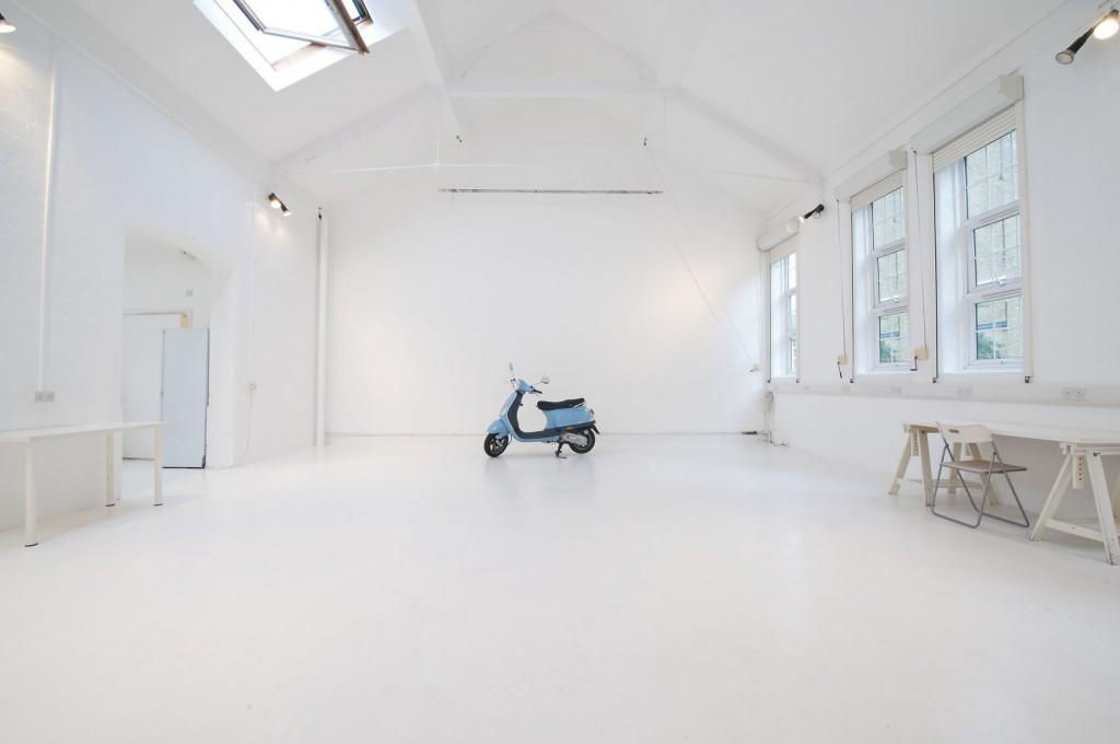 large photography studio with blue motorbike