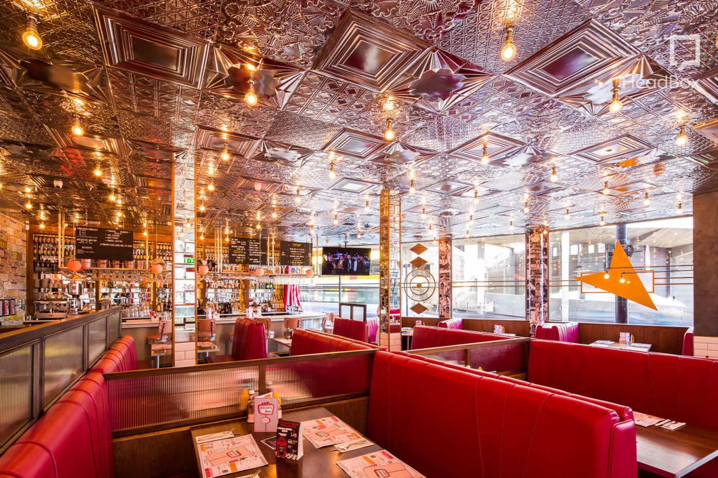 An American style diner with red booths